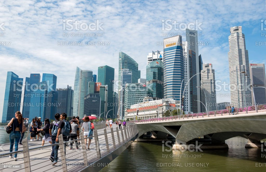 SINGAPORE - MAR 21, 2017 : Singapore city skyline or cityscape and financial district. Shot at street walk on Anderson Bridge on March 21, 2017 in Singapore. stock photo