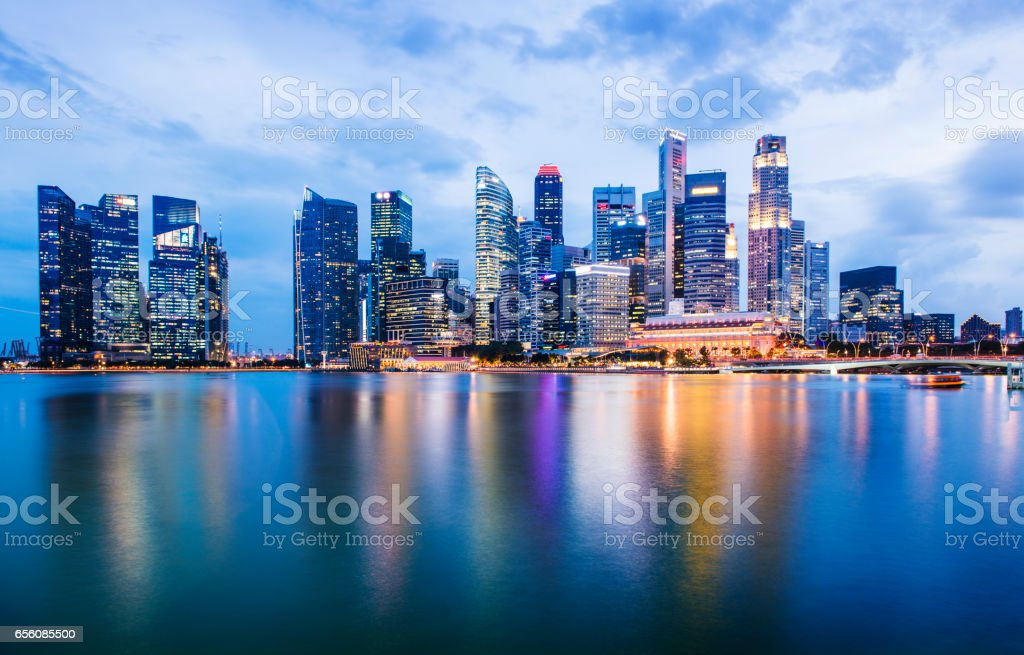 Singapore City Skyline With Reflection in the Still Water at Marina Bay during Twilight stock photo