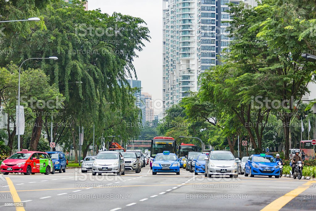 Singapore City Traffic Singapore, Singapore - August 12, 2015: Traffic at a busy intersection on the streets of Singapore Asia Stock Photo