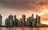 Singapore downtown core sky high buildings with fiery clouds
