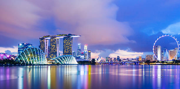singapore cityscape during sunset - singapore stock photos and pictures