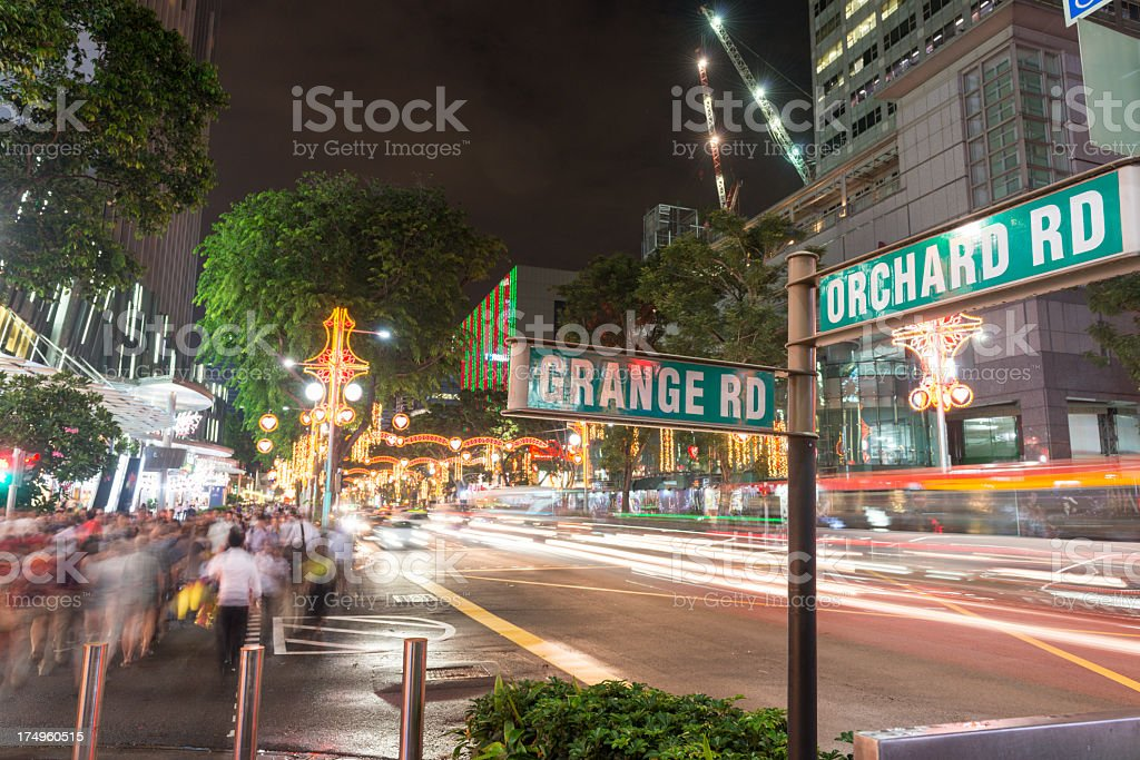 Singapore crossway with timelapsed people stock photo