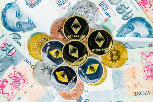 Singapore Dollar banknotes and Bitcoin Cryptocurrency and Ethereum coins on White background stock photo