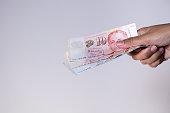 istock Singapore dollars in female hands 1222787281