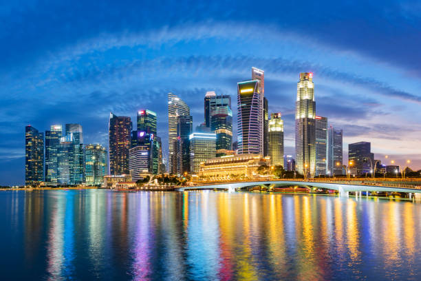 singapore financial district skyline at marina bay on twilight time. - singapore stock photos and pictures