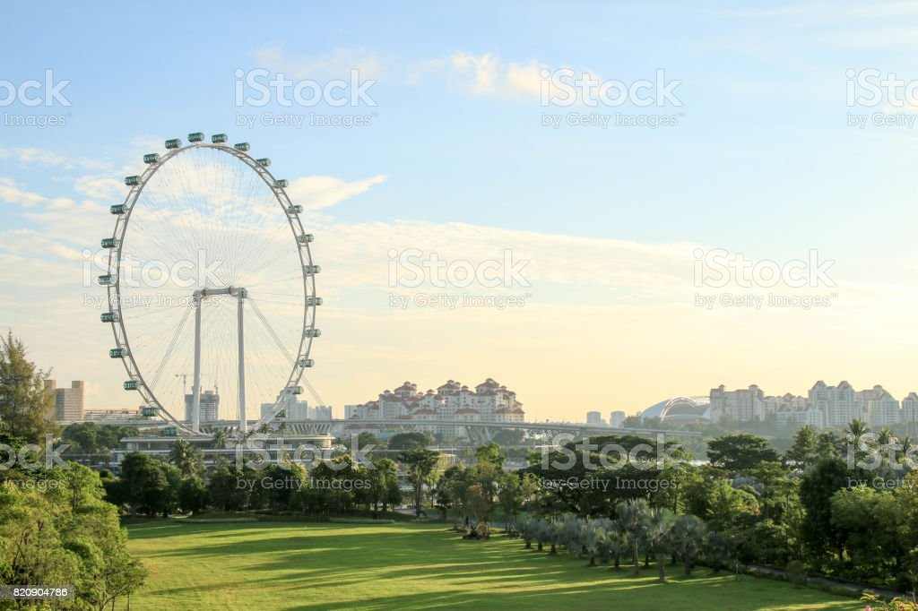 Singapore - JULY 10, 2017 : Singapore Flyer at morning - the Largest Ferris Wheel in the World. stock photo