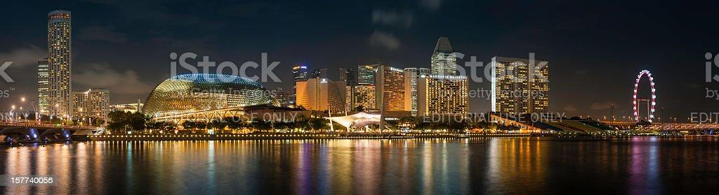 Singapore Flyer Esplanade Theatre Marina Bay hotels illuminated panorama stock photo