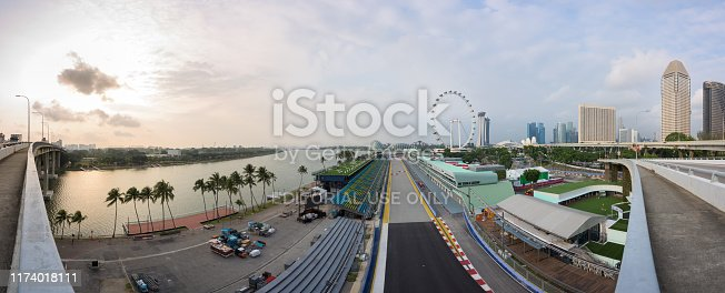 Singapore - 9 Sep 2019: the Marina Bay Street circuit is getting ready to welcome the Singapore night race Formula One Grand Prix. The grandstand is looking over the Flyer Ferris wheel, the Gardens by the bay and the Sands resorts in this composite picture.