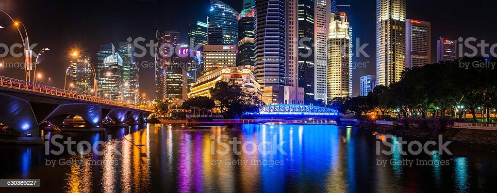 Singapore glittering skyscrapers illuminated neon night futuristic crowded cityscape panorama stock photo