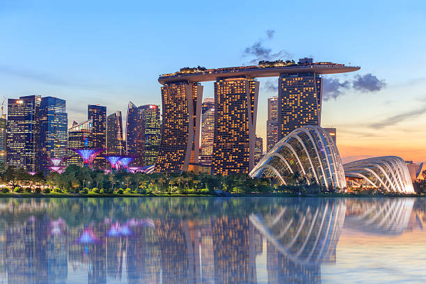 singapore glowing at night - singapore stock photos and pictures