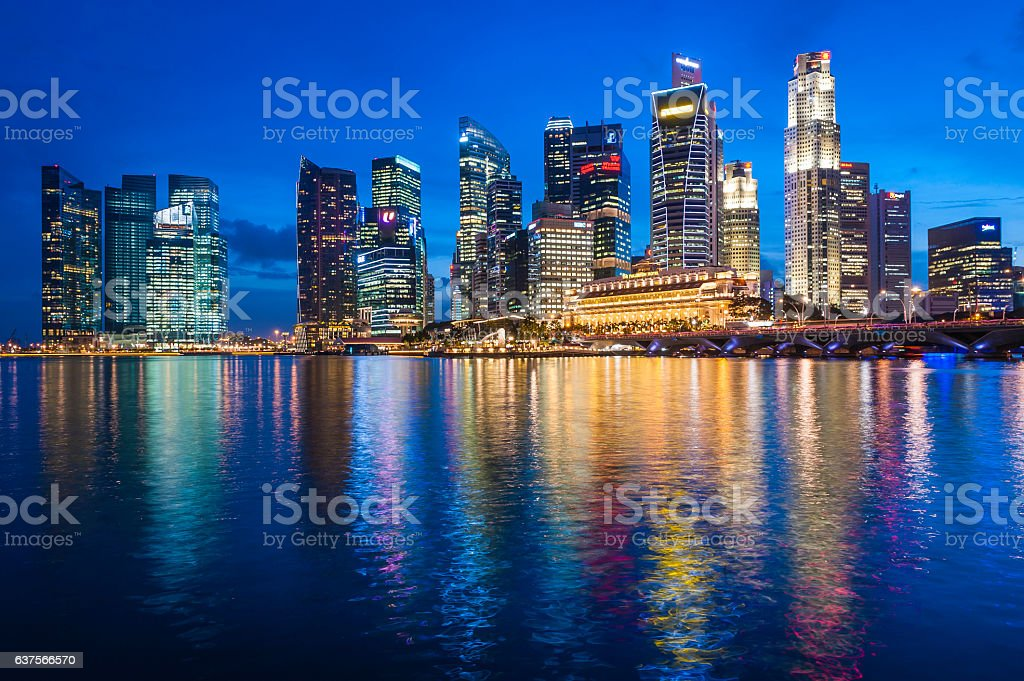 Singapore illuminated neon skyscrapers of Downtown Core overlooking Marina Bay stock photo