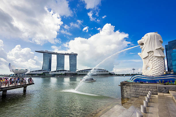 Singapore Landmarks Merlion Statue and Marina Bay Sands Hotel Singapore City, Singapore - June 1, 2014: View of Singapore landmarks Merlion statue and Marina Bay Sands Hotel in Singapore City.  merlion fictional character stock pictures, royalty-free photos & images