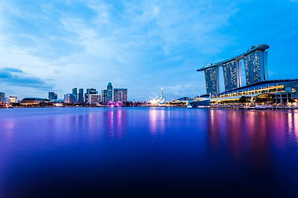 singapore marina bay at dusk - marina bay sands stock photos and pictures
