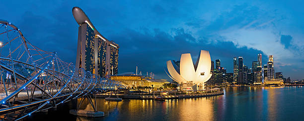 singapore marine bay sands illuminated - marina bay sands stock photos and pictures
