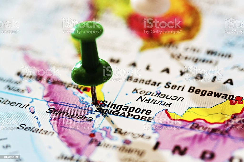 Singapore marked by green pushpin on map royalty-free stock photo