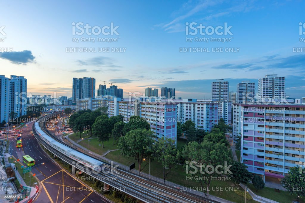 Singapore mass rapid train travels on the track stock photo