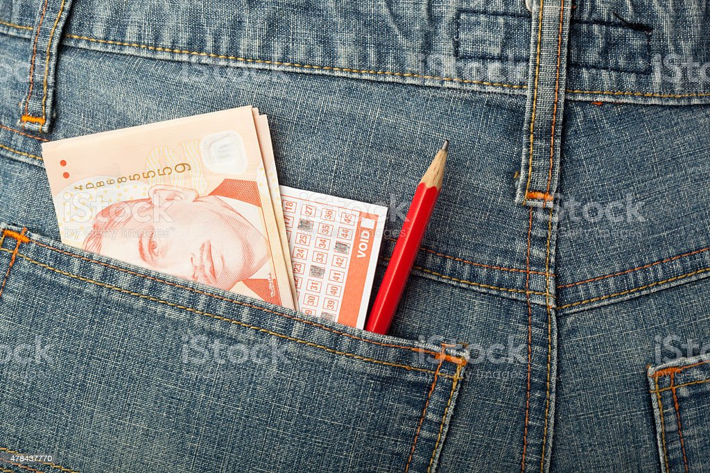 Singapore money and lottery bet slip in pocket stock photo