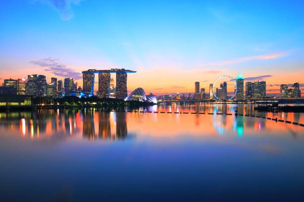 singapore night skyline (after sunset) at the marina bay - singapore stock photos and pictures