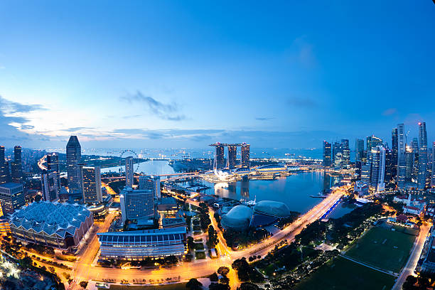 Singapore Panorama Aerial view of Singapore at sunrise. Shot taken with fisheye lens. esplanade theater stock pictures, royalty-free photos & images