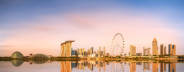 Singapore Skyline and view of Marina Bay Singapore Skyline and view of skyscrapers on Marina Bay merlion fictional character stock pictures, royalty-free photos & images