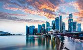 istock Singapore Skyline at Marina Bay at Twilight with glowing sunset illuminating the clouds 1176969551