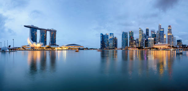 singapore skyline at night. - marina bay sands stock photos and pictures