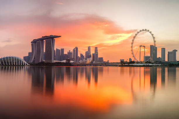 singapore skyline at sunset time in singapore city - singapore stock photos and pictures