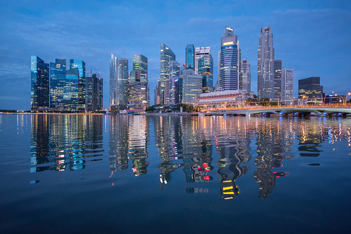 Singapore Skyline Singapores Business District Blue Sky And Night View For Marina Bay Stock Photo - Download Image Now