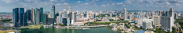 Singapore skyscraper skyline Marina Bay aerial panorama High angle panoramic vista across Singapore's iconic Central Business District skyline, from the landmark Marina Bay developments to the soaring skyscrapers of downtown and the spiky shells of the Esplanade Theatres on the Bay. ProPhoto RGB profile for maximum color fidelity and gamut. merlion fictional character stock pictures, royalty-free photos & images