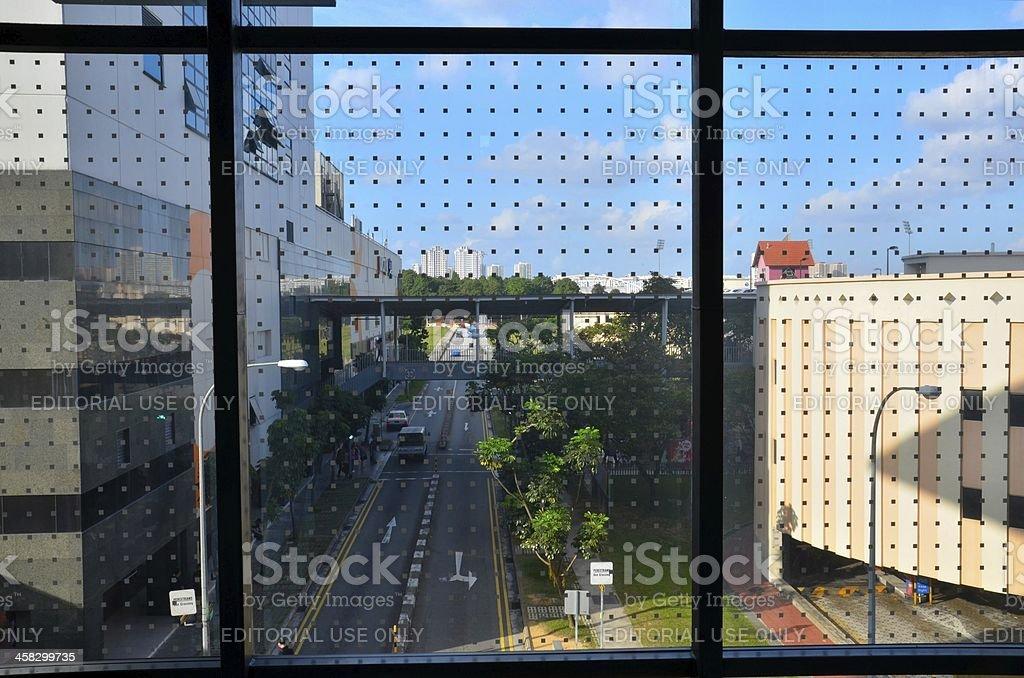 Singapore street scene viewed through dotted glass window royalty-free stock photo