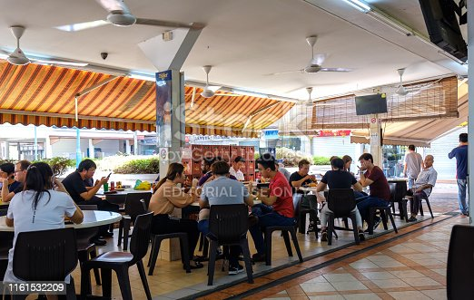 Singapore-22 FEB 2019:Singapore normal   traditional food count hawker center in residential area view.its use open public space.