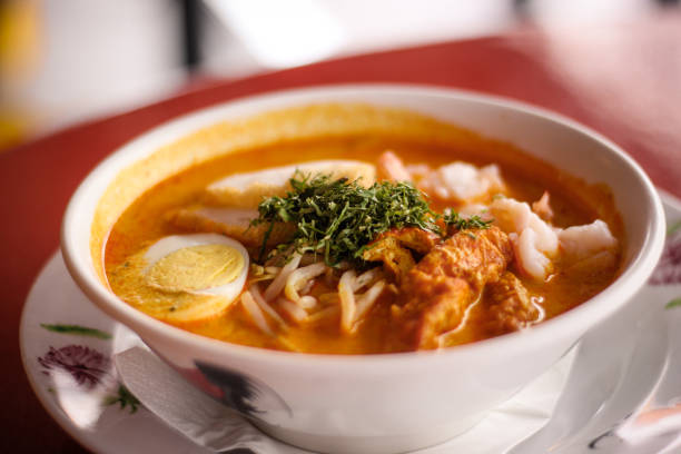 Singaporean Laksa Soup Singaporean Laksa Soup with coconut broth and seafood singapore laksa stock pictures, royalty-free photos & images