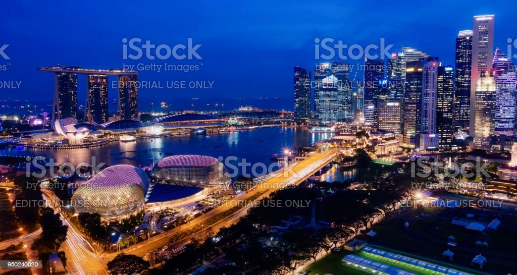 Singapore's harbor and city skyline lit up at dusk during the blue hour. Photo taken from the 35th floor. stock photo