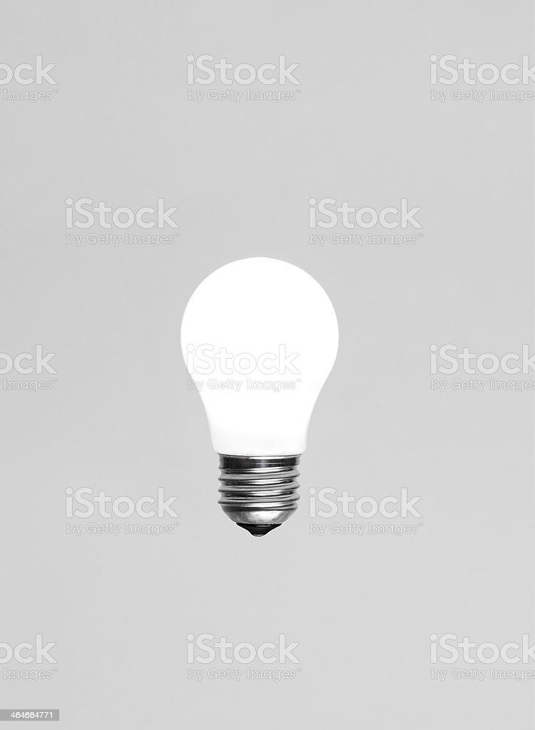 Singel glowing light bulb stock photo