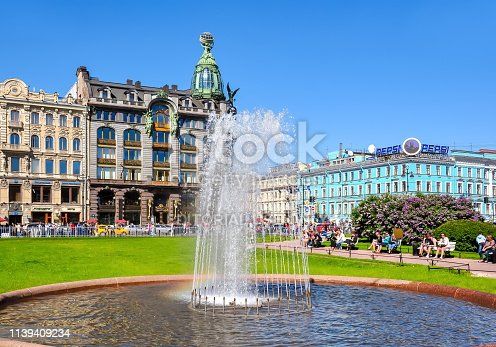 Saint Petersburg, Russia - June 2018: Singer (Zinger) House on Nevsky prospect and fountain on Kazan square