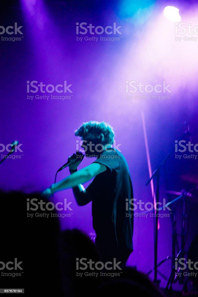 Singer in blue stock photo