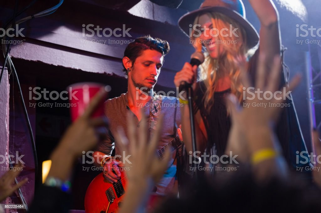 Singer performing on stage stock photo