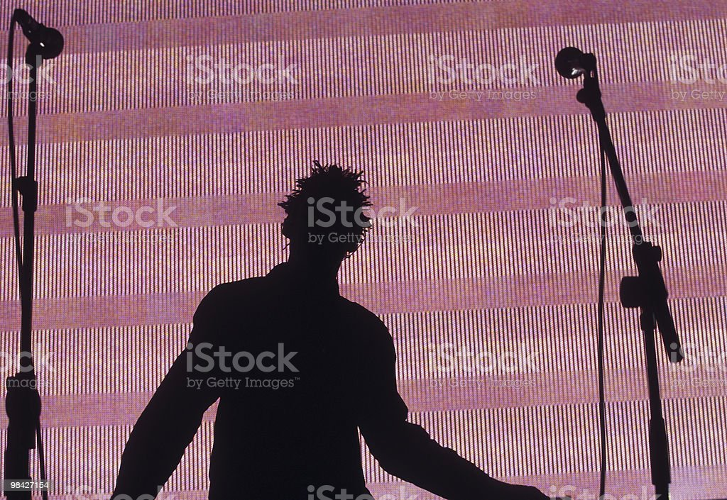 Singer silhouetted against a pink screen royalty-free stock photo