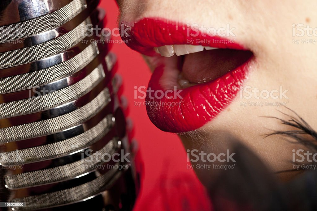 Singer singing in microphone stock photo
