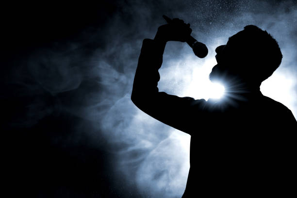 Singer singing silhouette Singer singing silhouette singer stock pictures, royalty-free photos & images