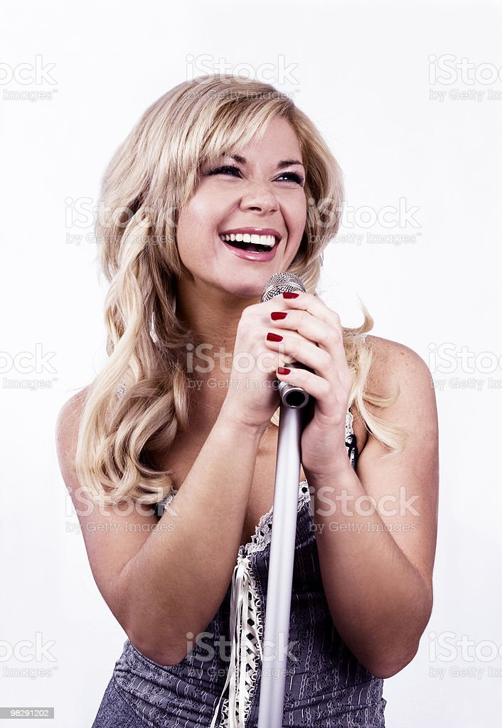 Singer. Young girl singing into microphone. royalty-free stock photo