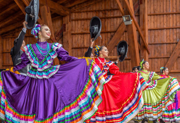 """Singers from Mexico in traditional costume Timisoara: Group of dancers from Mexico in traditional costume present at the international folk festival """"International Festival of hearts"""" organized by the City Hall. tradition stock pictures, royalty-free photos & images"""