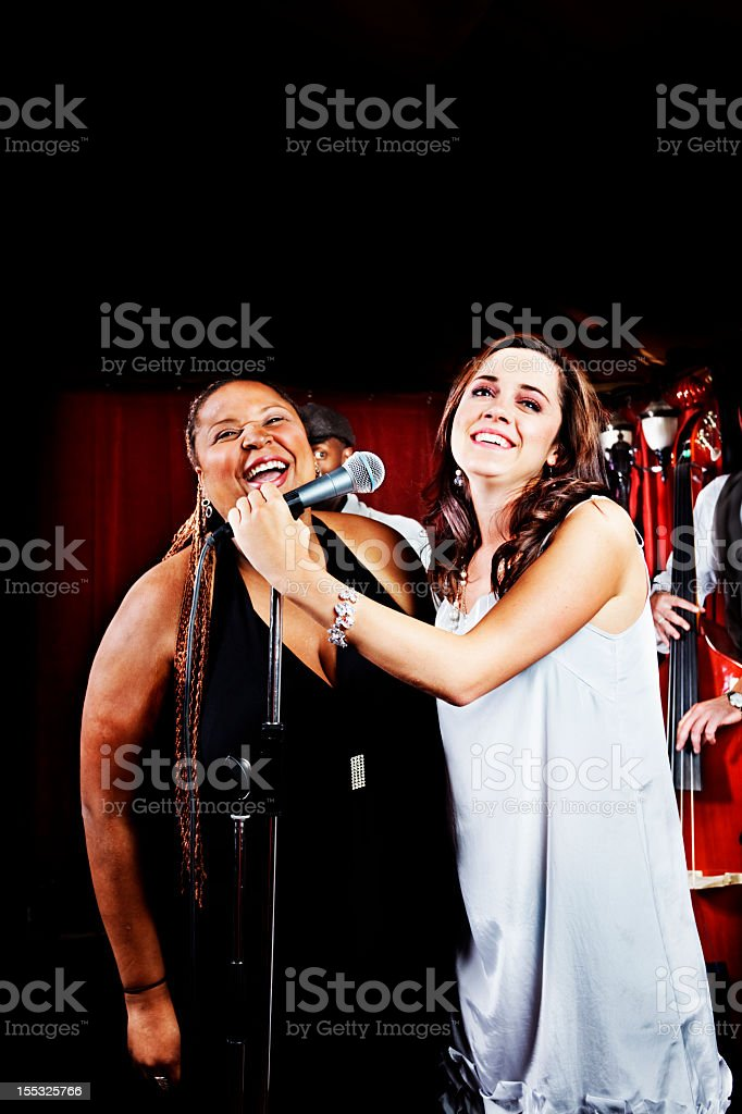 Singers having a laugh stock photo