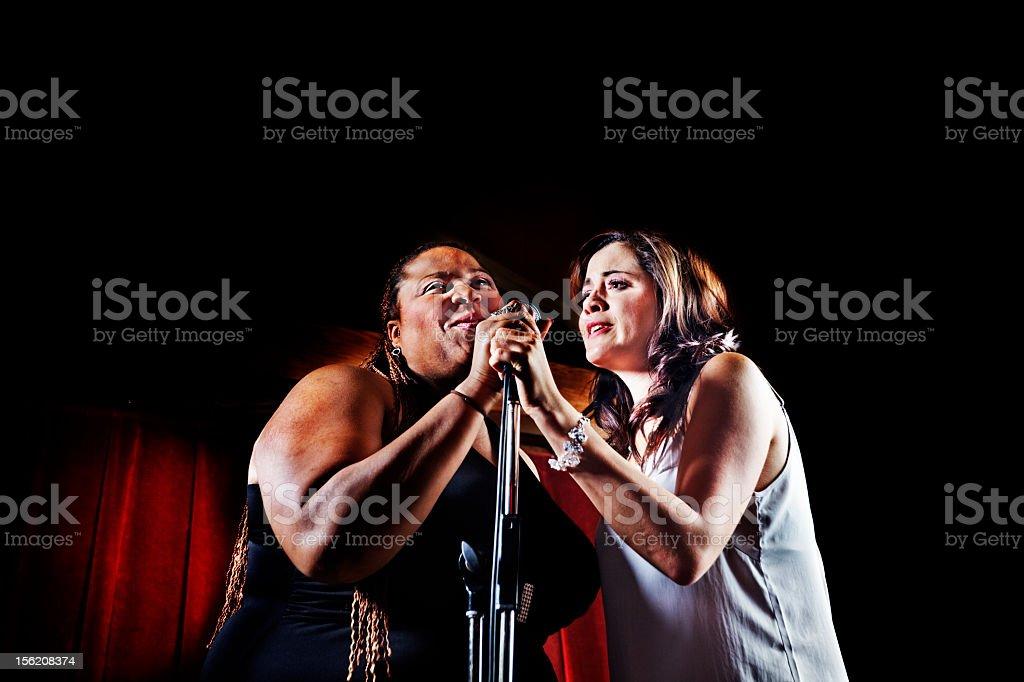 Singers in the spotlight stock photo