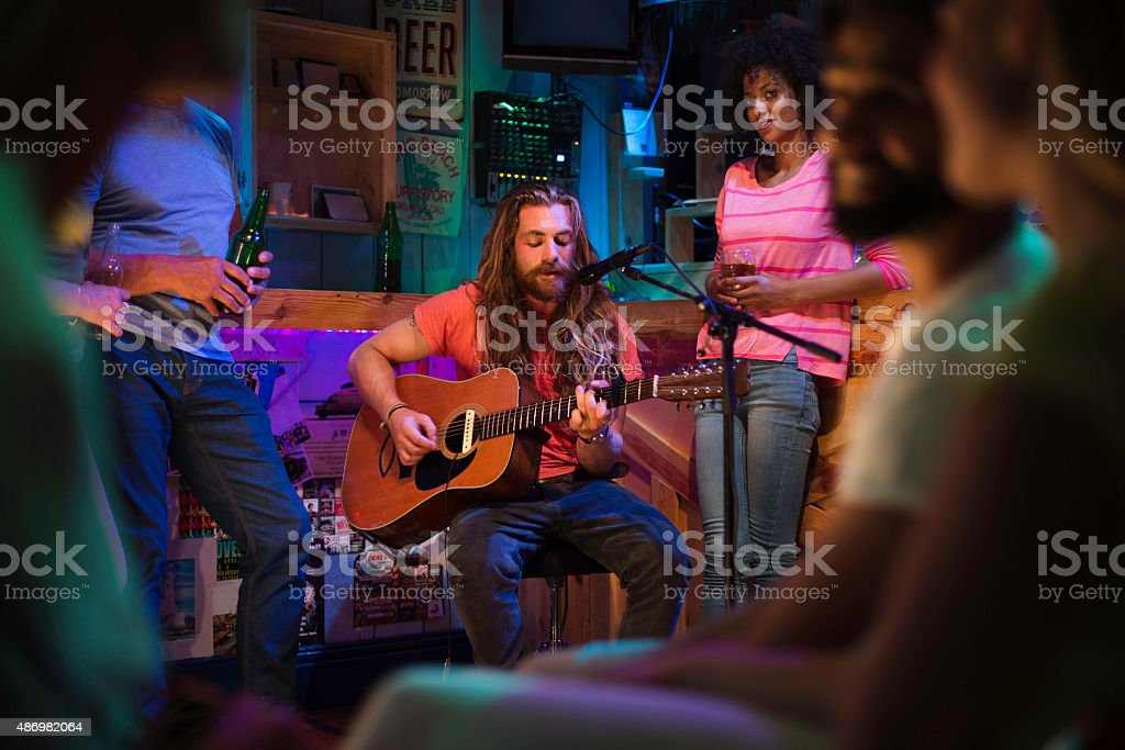 Singer/Songwriter Playing in Local Bar stock photo