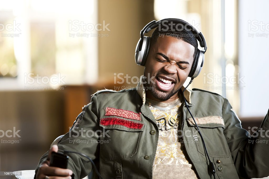 Singing Along with Music on Headphones stock photo