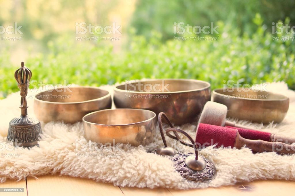 Singing bowl and other religious Tibetan musical instruments stock photo