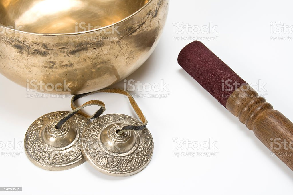 Singing bowl and Tibetan tingshas stock photo
