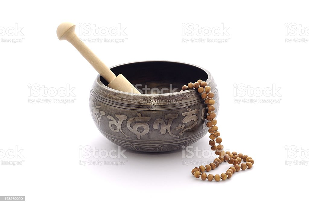 Singing bowl and wooden rosary isolated on a white. stock photo
