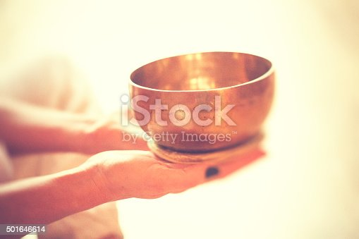 Singing bowl in hands